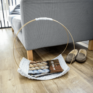 Watch the simple video tutorial to make a DIY magazine rack for your minimalist home.