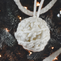 a easy crochet christmas ornament hanging on a tree