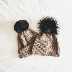 a ribbed beanie with large pom pom and slouchy crochet beanie