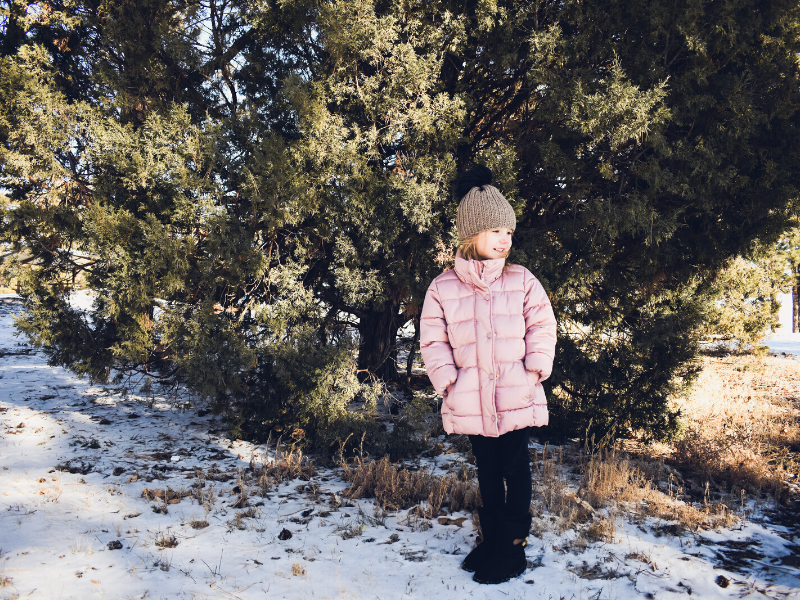 wooded area with girl wearing a fitted crocheted beanie